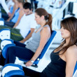 Exercising at the gym - Stock Photo