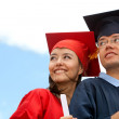 Couple of graduates outdoors — Stock Photo