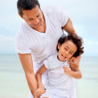 Man and son at the beach — Stock Photo #7732309