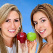 Women with apples isolated — Stock Photo #7732315