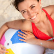 Woman with a beach ball — Stock Photo #7732344