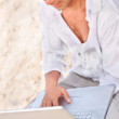 Man at the beach with laptop — Stock Photo