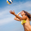 Stock Photo: Woman playing volleyball