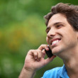 Man outdoors on the phone — Stock Photo