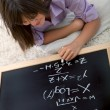 Woman studying maths - Stock Photo