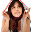 Woman with a book on her head — Stock Photo #7732498