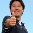 Man with thumbs-up — Stock Photo