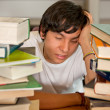 Tired student at the library — Stock Photo