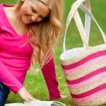 Woman reading outdoors — Stock Photo