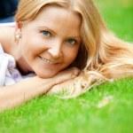 Woman liying on grass — Stock Photo