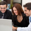 Business group on a laptop — Stock Photo