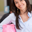 Stock Photo: Bsuiness womwith piggy bank