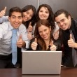 Business group with thumbs up - Stock Photo