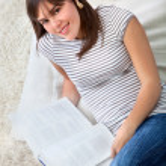 Woman on the floor studying — Stock Photo