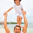 Father and son at the beach - Foto Stock