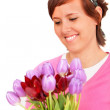 Stock Photo: Beautiful womwith some flowers