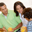 Family shopping for groceries - Stock Photo