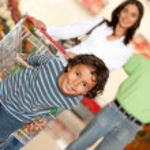 Family at the supermarket — Stock Photo