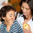 Stock Photo: Womand son eating fruits
