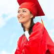 Stock Photo: Graduated womoutdoors