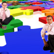 Business men with a puzzle - Stock Photo