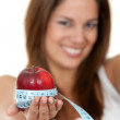 Woman with apple and measure tape — Stockfoto