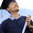 Stock Photo: Happy graduated man