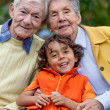 Kid with his grandparents — Stock Photo