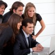 Business team with a laptop — Stock Photo #7736290
