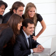 Royalty-Free Stock Photo: Business team with a laptop
