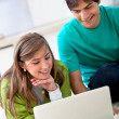 Couple with laptop — Stock Photo #7736309