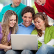 Group of friends with a laptop — Stock Photo