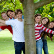 Friends behind a tree — Stock Photo
