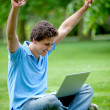 Excited man with computer — Stock Photo
