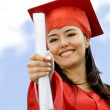 Stock Photo: Happy graduated woman