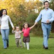 Foto Stock: Family running outdoors