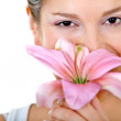Beautiful woman with a flower - Stock Photo
