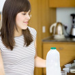 Girl serving milk — Stock Photo #7736503