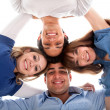 Group of with heads together — Stock Photo #7736545