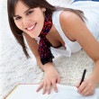 Stock Photo: Beautiful woman studying