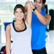 Gym woman with her trainer — Stock Photo #7736638