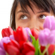Stock Photo: Womwith bunch of flowers