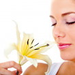 Woman smelling a flower — Stock Photo