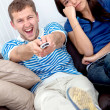 Couple watching tv — Stockfoto