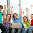 Stock Photo: Exited group of friends