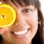 Woman with an orange — Stock Photo #7737091
