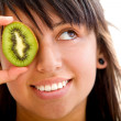 Woman with a kiwi — Stock Photo