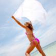 Bikini woman feeling the wind — Stock Photo #7737115
