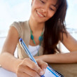 Female writing on a notebook — Stock Photo