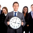 Foto Stock: Business group with clock